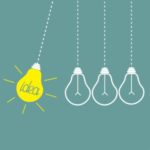 Four hanging yellow light bulbs. Perpetual motion. Idea concept.